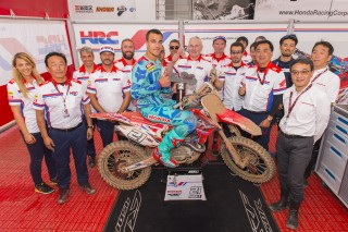 Team HRC celebrate Paulin's second overall